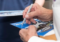 Richard Petty, Nascar legend, signs his autograph for a member of team Ramstein on Ramstein Air Base, Germany, Jan. 27, 2018. United States Air Force Recruiting Europe invited Petty to answer questions about his career for young men and women in the process of joining the Air Force, in part because the Air Force Recruiting Service sponsors Petty and Richard Petty Motor Sports, which displays the Air Force symbol on Nascar racecar number 43. (U.S. Air Force photo by Senior Airman Elizabeth Baker)