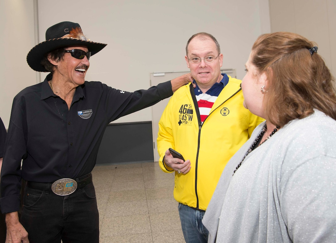 Richard Petty, left, Nascar legend, meets Brig. Gen. Richard G. Moore Jr., middle, 86th Airlift Wing commander, and Moore's spouse, Kristin, on Ramstein Air Base, Germany, Jan. 27, 2018. The 86th Force Support Squadron, United States Air Force Recruiting Europe, the Kaiserslautern Military Community Center, and Military Auto Source brought Petty to Ramstein to participate in Air Force recruiting and help raise money for Paralyzed Vererans of America. (U.S. Air Force photo by Senior Airman Elizabeth Baker)