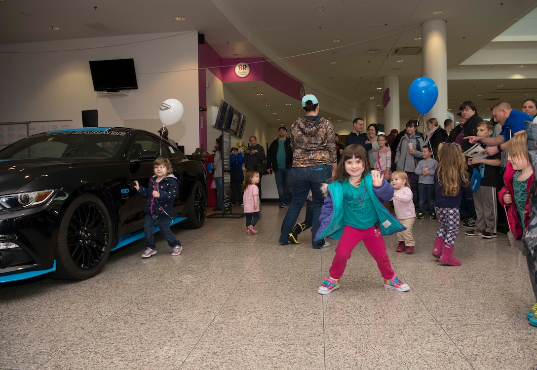 Children dance while waiting to see Richard Petty, Nascar legend, at a Kaiserslautern Military Community Center event on Ramstein Air Base, Germany, Jan. 27, 2018. Petty spoke with members of Team Ramstein, signed autographs, and participated in a question and answer session. (U.S. Air Force photo by Senior Airman Elizabeth Baker)