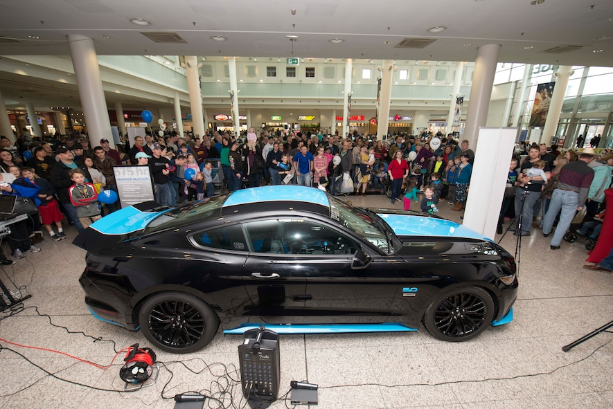 Members of Team Ramstein wait to see Richard Petty, Nascar legend, at the Kaiserslautern Military Community Center on Ramstein Air Base, Germany, Jan. 27, 2018. Petty, in partnership with Military Auto Source, came to Ramstein to help raise money for Paralyzed Veterans of America. (U.S. Air Force photo by Senior Airman Elizabeth Baker)