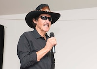 Richard Petty, Nascar legend, speaks to members of Team Ramstein at the Kaiserslautern Military Community Center on Ramstein Air Base, Germany, Jan. 27, 2018. Petty spoke about his career with young men and women in the process of joining the military, met various Team Ramstein leadership, and answered questions at an open event for the Kaiserslautern Military Community. (U.S. Air Force photo by Senior Airman Elizabeth Baker)