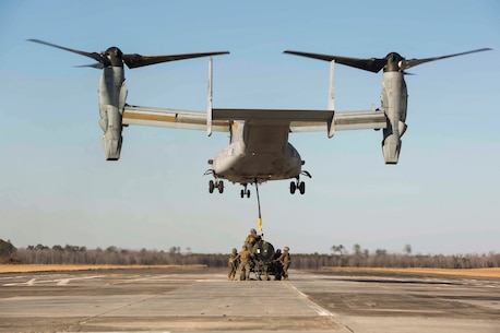 Marines with Landing Support Company, 2nd Transportation Support Battalion, 2nd Marine Logistics Group attach a 400 gallon M-149 water tank trailer to an MV-22 osprey during sling load operations at Camp Lejeune, N.C., Jan. 25, 2018. The Marines conducted sling load operations to improve their proficiency with loading equipment onto aircraft for transportation. (U.S. Marine Corps photo by Sgt. Chris Garcia)
