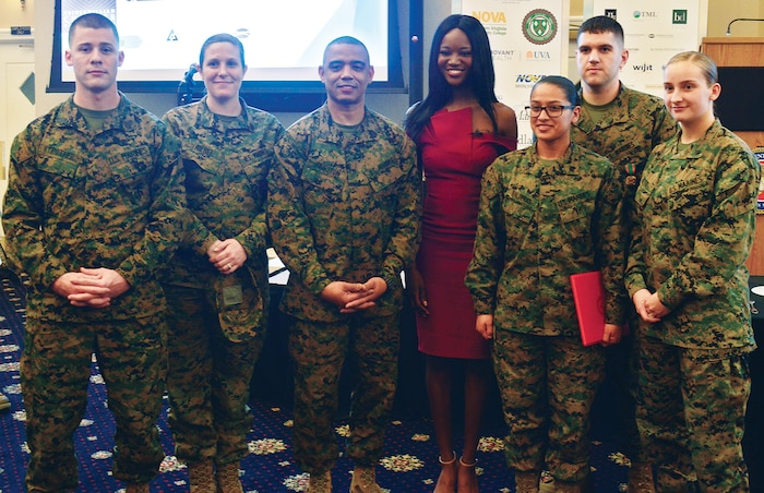 Marines join Miss USA 2016 and Army Reserve Capt. Deshauna Barber for a photograph after her keynote speech at the Prince William County Chamber of Commerce Veterans Council Salute to the Armed Forces lunch at The Clubs at Quantico.