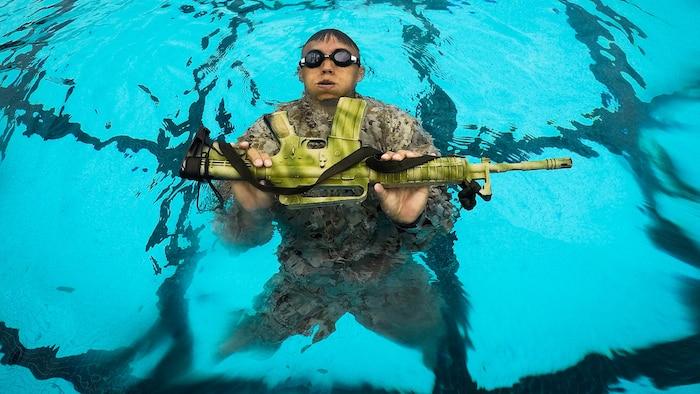 A U.S. Marine Corps infantryman with Detachment 4th Force Reconnaissance Company conducts a pool training event, Marine Corps Base Hawaii, Jan. 22, 2018.