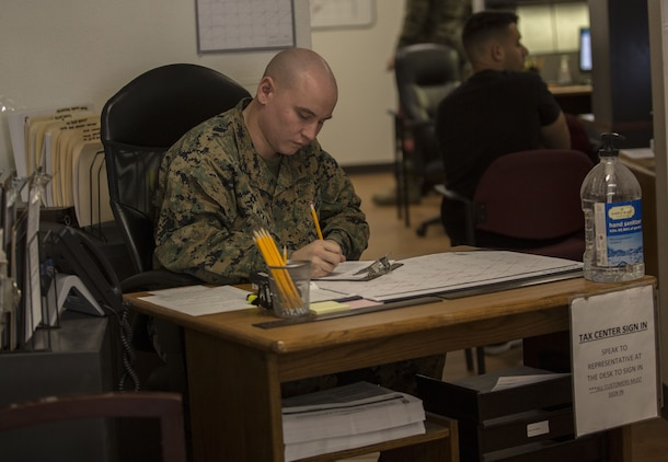 U.S. Marine Corps Lance Cpl. Daniel McKinstry, an airframe mechanic assigned to the Search and Rescue Unit with Headquarters & Headquarters Squadron, completes initial paperwork for clients that want to have their taxes prepared by the Volunteer Income Tax Assistance (VITA) Tax Center at Marine Corps Air Station (MCAS) Yuma, Ariz., Jan. 22, 2018. The VITA Tax Center offers free tax preparation to all service members, Department of Defense employees, and family members at MCAS Yuma. (U.S. Marine Corps photo taken by Lance Cpl. Sabrina Candiaflores)