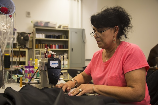 Isabel Andrade, a seamstress at the station dry-cleaners, alters a U.S. Marine Corps dress blue skirt at the dry-cleaners on Marine Corps Air Station Yuma, Ariz., Jan. 10, 2017. The station dry-cleaners is a service provided by the Marine Corps Exchange (MCX) to Marines and civilians, which provides them the opportunity to get their garments cleaned, pressed, fitted, altered or a combination of services if needed. (U.S. Marine Corps photo taken by Cpl. Isaac Martinez)