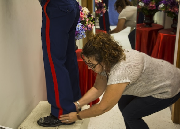 Blanca Quintero, a seamstress at the station dry-cleaners, measures a U.S. Marine's dress blue trousers for alterations at the dry-cleaners on Marine Corps Air Station Yuma, Ariz., Jan. 10, 2017. The station dry-cleaners is a service provided by the Marine Corps Exchange (MCX) to Marines and civilians, which provides them the opportunity to get their garments cleaned, pressed, fitted, altered or a combination of services if needed. (U.S. Marine Corps photo taken by Cpl. Isaac Martinez)