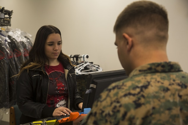 Jasmine Templin, the dry-cleaner's supervisor, rings up a U.S. Marine's order at the dry-cleaners on Marine Corps Air Station Yuma, Ariz., Jan. 10, 2017. The station dry-cleaners is a service provided by the Marine Corps Exchange (MCX) to Marines and civilians, which provides them the opportunity to get their garments cleaned, pressed, fitted, altered or a combination of services if needed.  (U.S. Marine Corps photo taken by Cpl. Isaac Martinez)