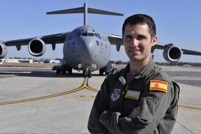 Capt. David Martinez Guillen, a Spanish Air Force pilot attached to the 16th Airlift Squadron at Joint Base Charleston, poses in front of a C-17 Globemaster III Jan. 25, 2018, at Joint Base Charleston, S.C.