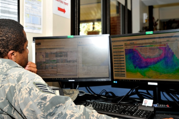 U.S. Air Force Staff Sgt. Maxime Estimable, 20th Operations Support Squadron weather flight weather forecaster, observes an hourly weather projection at Shaw Air Force Base, S.C., Jan. 26, 2018.