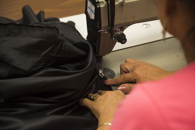 Isabel Andrade, a seamstress at the station dry-cleaners, alters a pair of U.S. Marine Corps service trousers at the dry-cleaners on Marine Corps Air Station Yuma, Ariz., Jan. 10, 2017. The station dry-cleaners is a service provided by the Marine Corps Exchange (MCX) to Marines and civilians, which provides them the opportunity to get their garments cleaned, pressed, fitted, altered or a combination of services if needed. (U.S. Marine Corps photo taken by Cpl. Isaac Martinez)