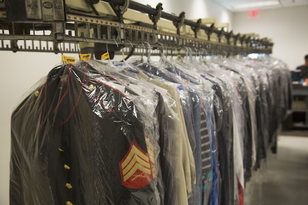 U.S. Marine Corps uniforms hang on turnstiles at the dry-cleaners on Marine Corps Air Station Yuma, Ariz., Jan. 10, 2017. The station dry-cleaners is a service provided by the Marine Corps Exchange (MCX) to Marines and civilians, which provides them the opportunity to get their garments cleaned, pressed, fitted, altered or a combination of services if needed. (U.S. Marine Corps photo taken by Cpl. Isaac Martinez)