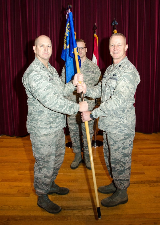 """Lt. Col. Robert """"South"""" Southerland takes command of the 131st Force Support Squadron from Col. Bill Boothman, acting 131st Mission Support Group commander, during a change of command ceremony at Whiteman Air Force Base, Missouri, Jan. 6, 2018."""