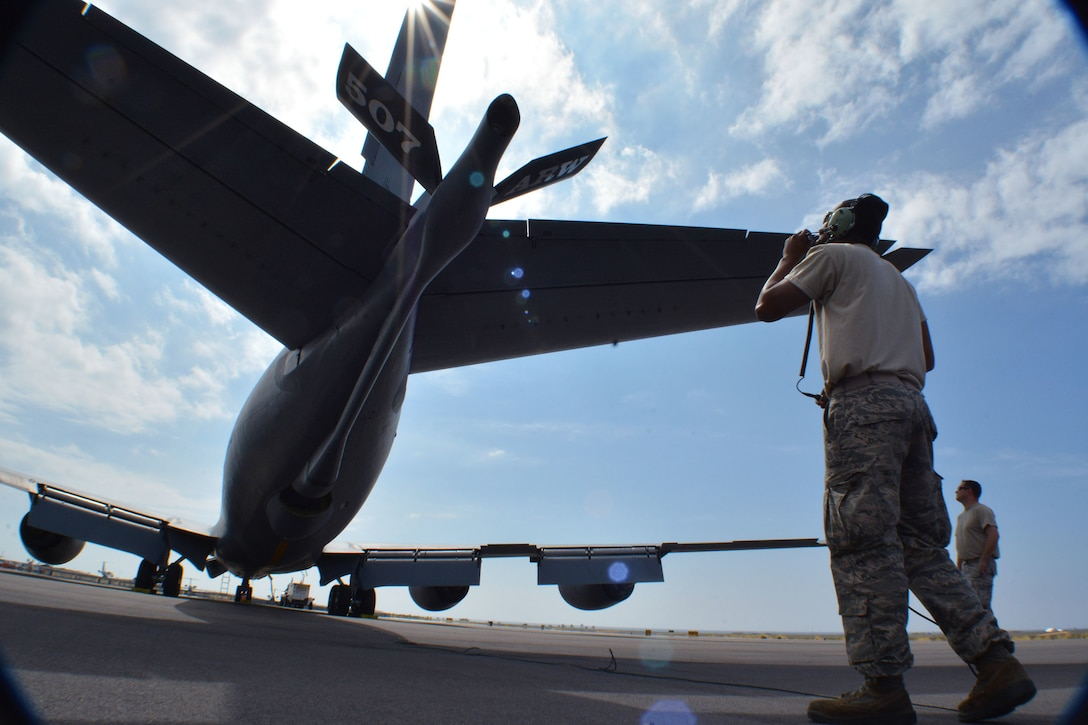 Crew chiefs from Tinker Air Force Base, Okla., Senior Airman Samuel Bryant, 507th Maintenance Squadron, and Tech. Sgt. Justin Nichols, 507th Aircraft Maintenance Squadron, prepare a KC-135 Stratotanker for flight Jan. 19, 2018, at Kona International Airport, Hawaii. 507th Air Refueling Wing air and maintenance crews flew the KC-135 to Hawaii in direct support of Exercise Sentry Aloha. (U.S. Air Force photo/Tech. Sgt. Samantha Mathison)