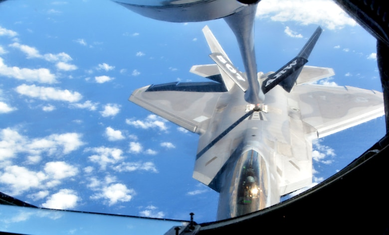 A 154th Wing Hawaii National Guard F-22 Raptor from Joint Base Pearl Harbor-Hickam, Hawaii, receives fuel from a 507th Air Refueling Wing KC-135R Stratotanker from Tinker Air Force Base, Okla., Jan. 22, 2018, in support of Exercise Sentry Aloha in Hawaii. (U.S. Air Force photo/Tech. Sgt. Samantha Mathison)