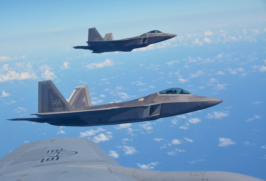 Two 154th Wing Hawaii National Guard F-22 Raptors from Joint Base Pearl Harbor-Hickam, Hawaii, fly alongside a 507th Air Refueling Wing KC-135R Stratotanker from Tinker Air Force Base, Okla., Jan. 22, 2018, in support of Exercise Sentry Aloha in Hawaii. (U.S. Air Force photo/Tech. Sgt. Samantha Mathison)