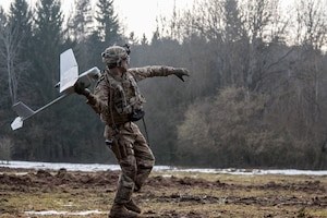 Army Spc. William Ritter, a military policeman with 287th Military Police Company, 97th Military Police Battalion, 89th Military Police Brigade, Fort Riley, Kan., prepares to launch the RQ-11 Raven, small unmanned aerial system into the air during Allied Spirit VIII at Hohenfels Training Area, Germany.