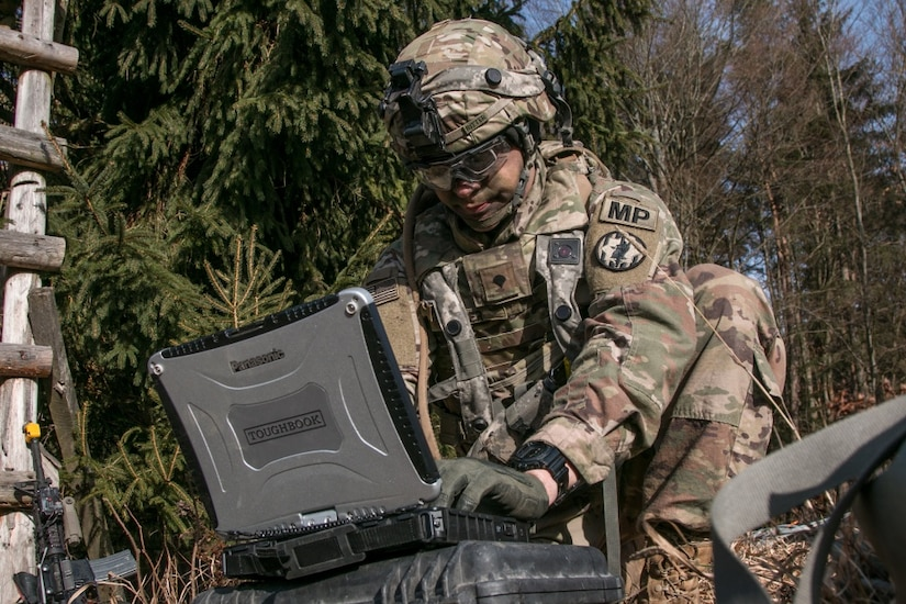 Army Spc. William Ritter, a military policeman with 287th Military Police Company, 97th Military Police Battalion, 89th Military Police Brigade, Fort Riley, Kan., sets up the software used to monitor and control the RQ-11 Raven, a small unmanned aerial system, during Allied Spirit VIII at Hohenfels Training Area, Germany.
