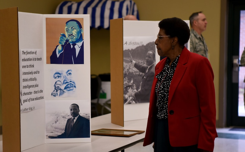 An attendee at a Martin Luther King Jr. observance event views information about King at the Air Base Chapel Jan. 29, 2018.