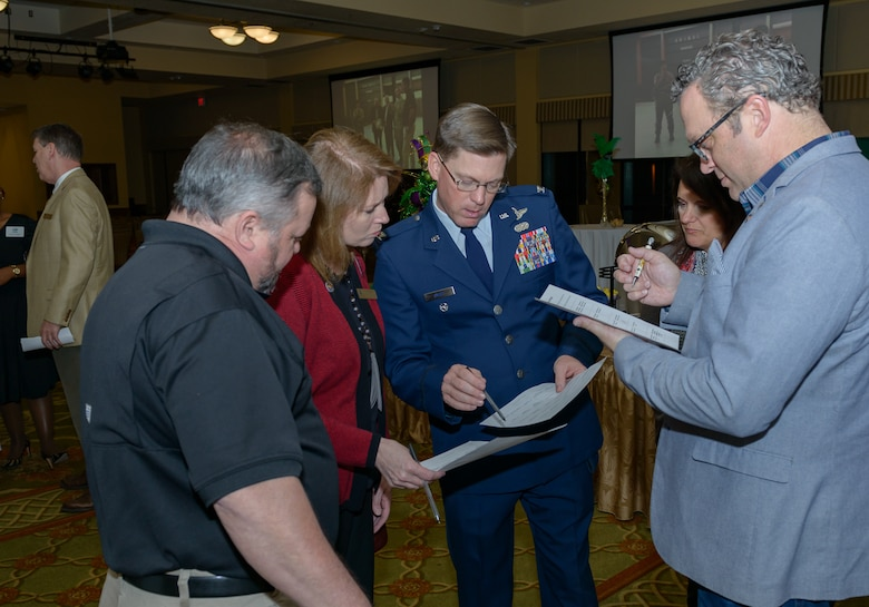 Col. Mike Smith, 81st Training Wing vice commander, assists honorary commanders in an icebreaker game during the 2018 Honorary Commanders Induction Ceremony at the Bay Breeze Event Center Jan. 26, 2018, on Keesler Air Force Base, Mississippi. The event recognized the newest members of Keesler's honorary commanders program, which is a partnership between base leadership and local civic leaders to promote strong ties between military and civilian leaders. (U.S. Air Force photo by André Askew)