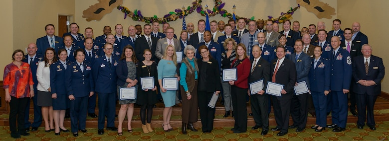 Keesler leadership poses for a group photo with current and newly inducted honorary commanders during the 2018 Honorary Commanders Induction Ceremony at the Bay Breeze Event Center Jan. 26, 2018, on Keesler Air Force Base, Mississippi. The event recognized the newest members of Keesler's honorary commanders program, which is a partnership between base leadership and local civic leaders to promote strong ties between military and civilian leaders. (U.S. Air Force photo by André Askew)