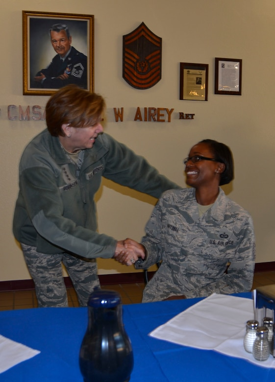 Gen. Lori Robinson, Commander, North American Aerospace Defense Command & Northern Command, greets Master Sgt. Megan Hartzell, 601st Air Operations Center, at a breakfast with Airmen at the Berg-Liles dining facility Jan. 18.  Pictured in the photo as a technical sergeant, Hartzell was recently promoted to her current rank. (Air Force Photo by Mary McHale)