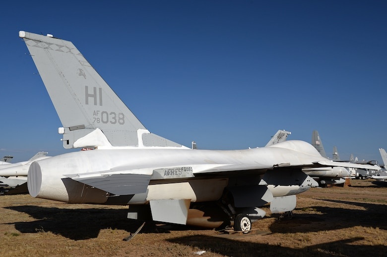 An F-16 Fighting Falcon, tail no. 78-0038, one of the oldest remaining F-16A aircraft and still wearing markings from its time with the Diamondbacks of the 419th Fighter Wing, sits in the 309th Aerospace Maintenance and Regeneration Group open-air storage yard, Davis-Monthan Air Force Base, Arizona, on June 7, 2016. Retired F-16s are stored here for an indefinite time and are often used for spare parts, regenerated for foriegn military sales, or put back into flying status and used as QF-16 full-scale aerial targets. (U.S. Air Force photo by Alex R. Lloyd)