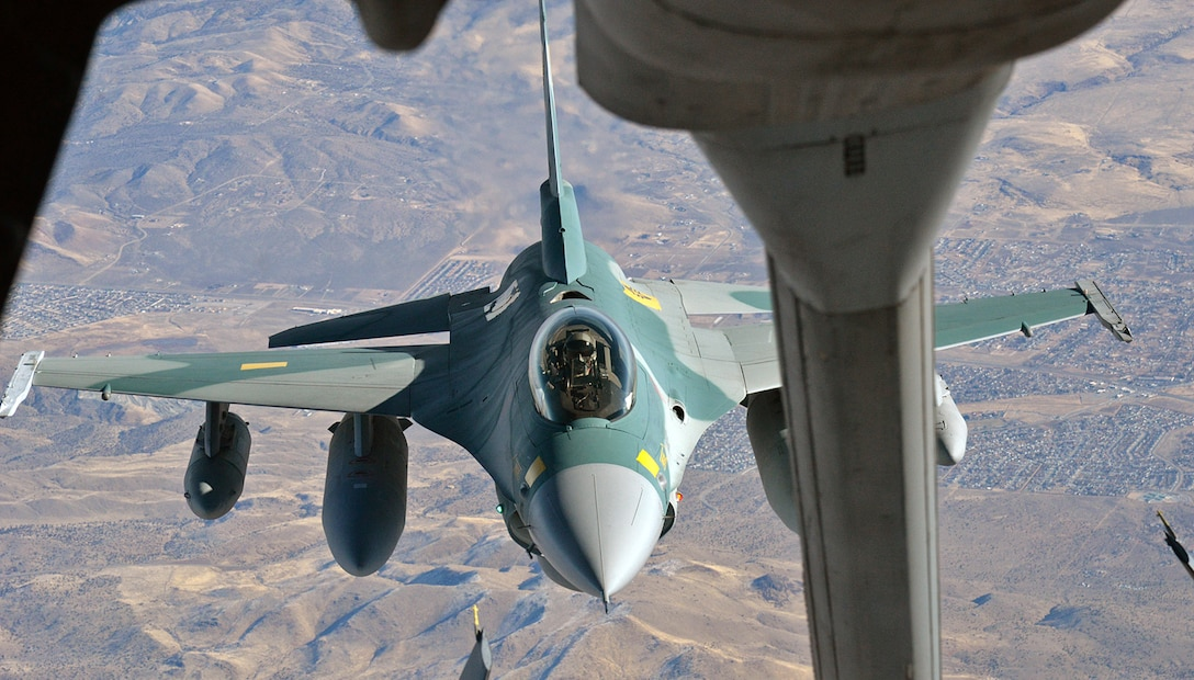 "Over Sun Valley, Nevada, Arizona National Guard pilot, Lt. Col. Gregory ""Ajax"" Gaff, positions his Indonesian F-16C behind a KC-10 Extender aerial refueling aircraft in preparation to receive fuel during a ferry flight from Hill Air Force Base, Utah, to Hickam AFB, Hawaii, on Dec. 6, 2017. The aircraft was fitted with three external tanks and be refueled several times during the six-and-a-half hour flight. (U.S. Air Force photo by Alex R. Lloyd)"