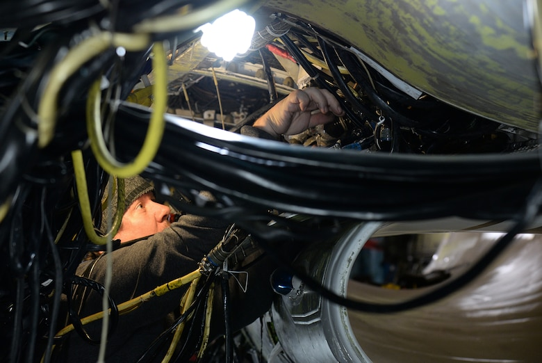 Bret Hadley, 573rd Aircraft Maintenance Squadron, performs an electronic check out on an F-16 undergoing service life extension program modification on Dec. 20, 2017, at Hill Air Force Base, Utah. The SLEP is a series of inspections and modifications taking place at one time to extend the aircraft flying service life to 2046. (U.S. Air Force photo by Alex R. Lloyd)