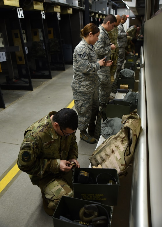 U.S. Airmen load magazines with ammunition during an M4 carbine qualification course at Shaw Air Force Base, S.C., Jan. 25, 2018.