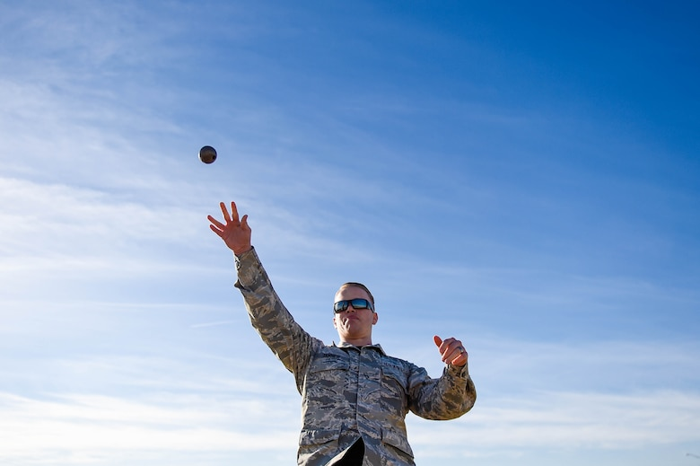 Senior Airman Devon Tanner, 56th Communications Squadron network infrastructure technician, throws a simulated grenade during a combat fitness test challenge at Luke Air Force Base, Ariz., Jan. 26, 2018. During the CFT, a Marine Corps physical fitness requirement, a simulated grenade was thrown into a pre-determined area in addition to other combat related tasks. The competition was held between Marines and Airmen to build esprit de corps among the two services. (U.S. Air Force photo/Staff Sgt. Jensen Stidham)