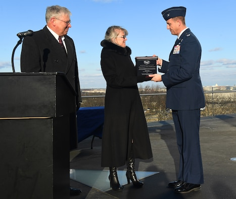 "Ms. Jonna Doolittle Hoppes, executive director of the Doolittle Foundation and granddaughter of Gen. James ""Jimmy"" Doolittle, and retired Lt. Gen. Christopher Miller, president of the Air Force Historical Foundation, present the General James H. ""Jimmy"" Doolittle award to Col. Julian Cheater on behalf of the 432nd Wing/432nd Air Expeditionary Wing Jan. 18, 2018, at Creech Air Force Base, Nev. The General James H. ""Jimmy"" Doolittle award is presented to units who display gallantry, determination, espirit de corps and superior management of joint operations in accomplishing its mission under difficult and hazardous conditions in multiple conflicts. (U.S. Air Force photo/Senior Airman James Thompson)"