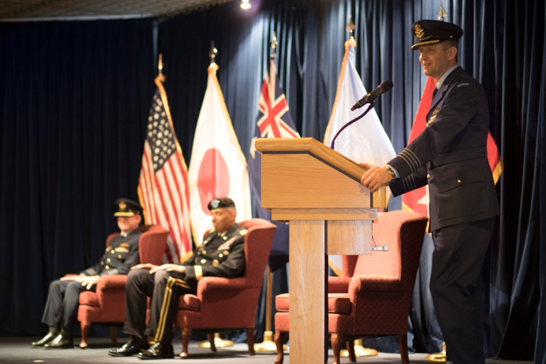 Royal Australian Air Force Group Captain Michael W. Jansen, outgoing United Nations Command (Rear) commander, gives his final speech during the UNC (Rear) change of command ceremony