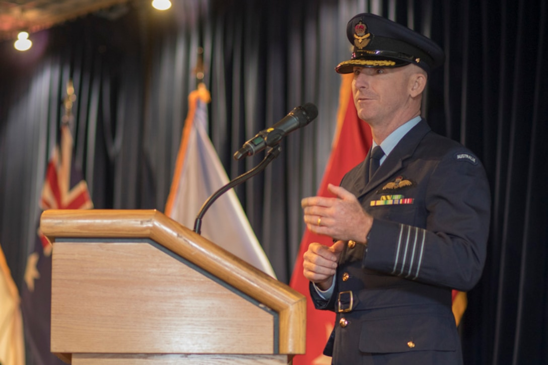 Royal Australian Air Force Group Captain Adam Williams, United Nations Command (Rear) commander, gives a speech during the UNC (Rear) change of command ceremony