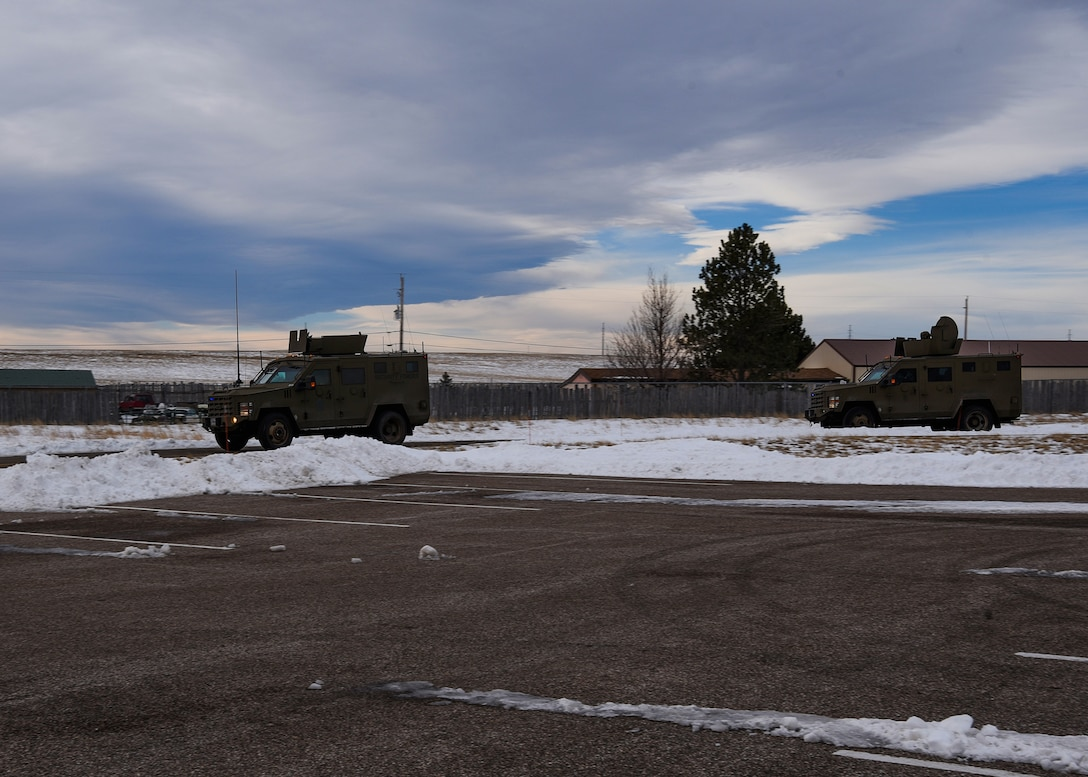 A convoy rolls out of F.E. Warren Air Force Base, Wyo., with non-security forces members for the first time Jan. 25, 2018. A Marine and an Air Force missileer rode inside a Humvee within the convoy, allowing them to cross-talk with other career fields. (U.S. Air Force photo by Airman 1st Class Abbigayle Wagner)