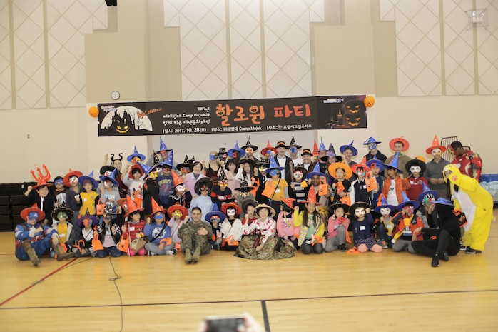 Participants pose for a photo at a Camp Mujuk Halloween event.