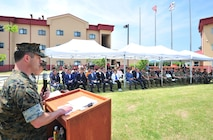 Camp Mujuk Commanding Officer, Lieutenant Colonel Horace J Bly addresses the crowd.