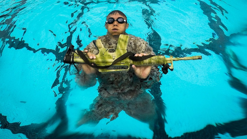 A U.S. Marine Corps infantryman with Detachment 4th Force Reconnaissance Company conducts a pool training event, Marine Corps Base Hawaii, Jan. 22, 2018.
