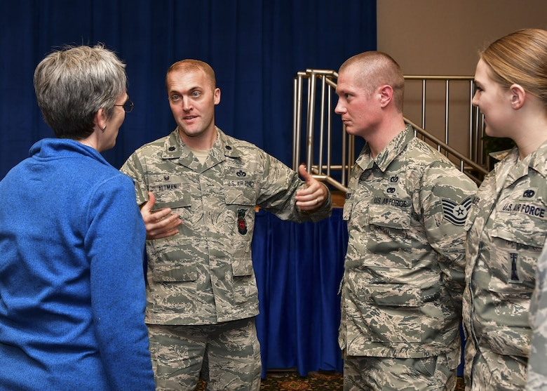 "Lt. Col. Matthew ""Devil"" Altman, 8th Civil Engineering Squadron, speaks to the accomplishments of his troop, Tech. Sgt. Adam Frazier, with Secretary of the Air Force Heather Wilson at Osan Air Base, Republic of Korea, January 29, 2018. Members of the Wolf Pack were recognized as superior performers by Wilson and Goldfein and briefed the senior leaders on the specific mission sets in their respective fields. (U.S. Air Force photo by Staff Sgt. Franklin R. Ramos)"