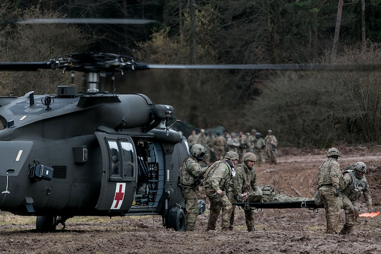 Army medics from the 557th Medical Company conduct rapid medical evacuation training during exercise Allied Spirit VIII at the Joint Multinational Readiness Center in Hohenfels, Germany, Jan. 29, 2018. Army photo by Spc. Dustin D. Biven