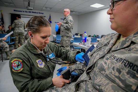 Medic takes vital signs