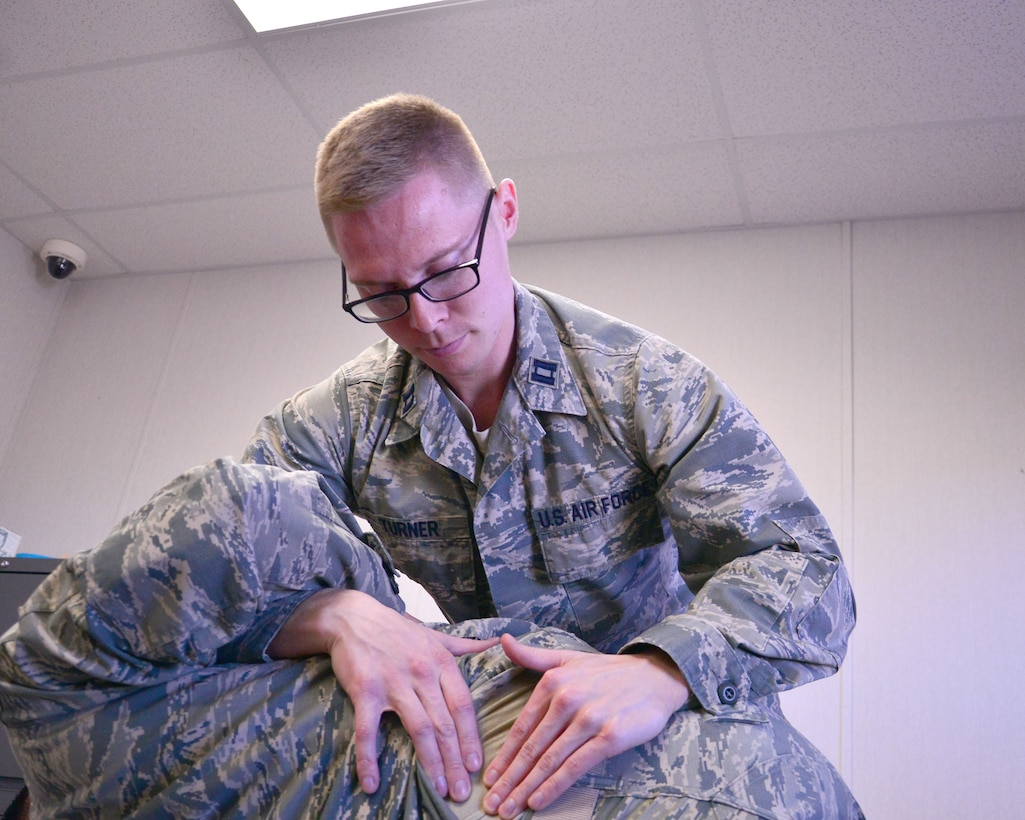 Schriever Air Force Base, Colo.— Capt. Jeffery Turner, physical therapist, 21st Medical Operations Squadron, applies pressure to a patients back during an appointment at Building T-135 portable trailer, Jan. 31, 2018.  The 21st Medical Group stood up a new satellite clinic at Schriever Air Force Base, Jan. 22. The clinic provides comprehensive musculoskeletal care including but not limited to: physical therapy evaluation, running analysis, sports/acute injury rehabilitation, advanced return to sports/duty rehabilitation and training. (U.S. Air Force photo by Staff Sgt. Matthew Coleman-Foster)