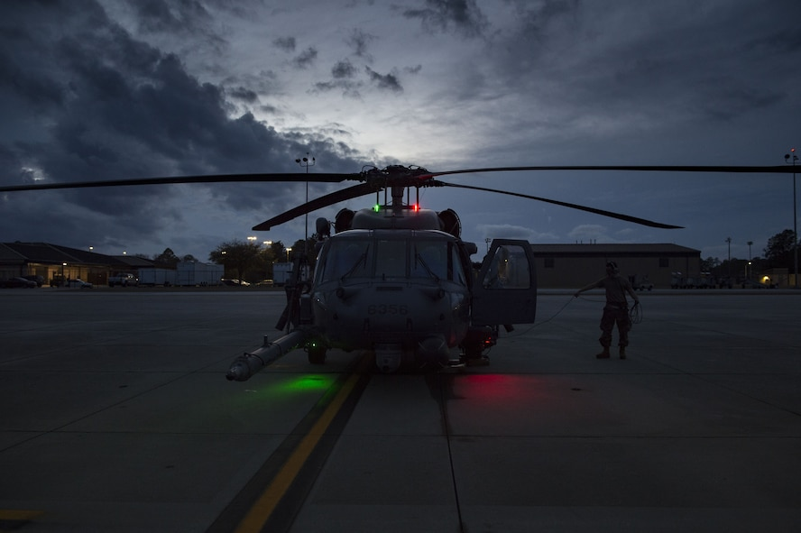 Airmen perform maintenance checks on an HH-60G Pave Hawk, Jan. 22, 2018, at Moody Air Force Base, Ga. The 41st RQS is responsible for maintaining combat-ready personnel for recovery missions. To achieve this, members of the squadron constantly train on day and nighttime operations to maintain proficiency. (U.S. Air Force photo by Senior Airman Janiqua P. Robinson)