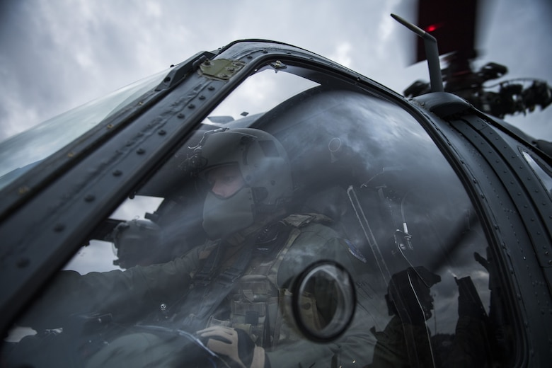 A pilot from the 41st Rescue Squadron starts the rotors an HH-60G Pave Hawk, Jan. 22, 2018, at Moody Air Force Base, Ga. The 41st RQS is responsible for maintaining combat-ready personnel for recovery missions. To achieve this, members of the squadron constantly train on day and nighttime operations to maintain proficiency. (U.S. Air Force photo by Senior Airman Janiqua P. Robinson)