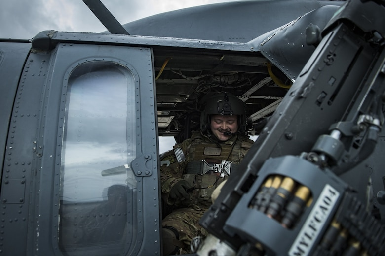 Senior Airman Joseph Lombardi, 41st Rescue Squadron special missions aviator, smiles while adjusting his gear, Jan. 22, 2018, at Moody Air Force Base, Ga. The 41st RQS is responsible for maintaining combat-ready personnel for recovery missions. To achieve this, members of the squadron constantly train on day and nighttime operations to maintain proficiency. (U.S. Air Force photo by Senior Airman Janiqua P. Robinson)