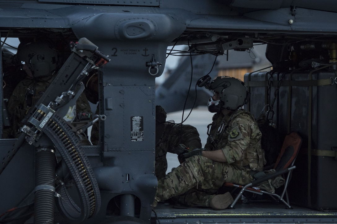 An Airman from the 41st Rescue Squadron performs preflight checks, Jan. 22, 2018, at Moody Air Force Base, Ga. The 41st RQS is responsible for maintaining combat-ready personnel for recovery missions. To achieve this, members of the squadron constantly train on day and nighttime operations to maintain proficiency. (U.S. Air Force photo by Senior Airman Janiqua P. Robinson)