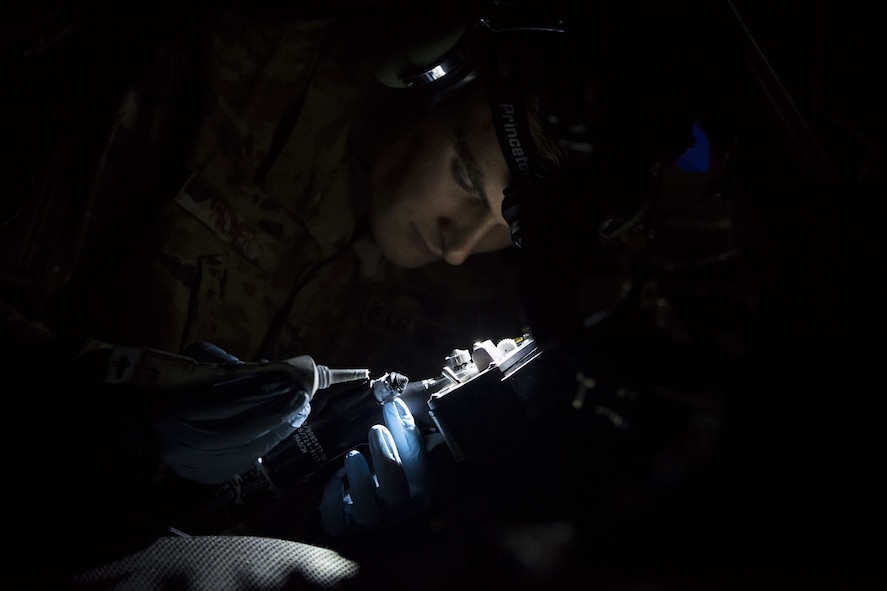 An Airman from the 41st Helicopter Maintenance Unit performs maintenance on an HH-60G Pave Hawk, Jan. 22, 2018, at Moody Air Force Base, Ga. The 41st RQS is responsible for maintaining combat-ready personnel for recovery missions. To achieve this, members of the squadron constantly train on day and nighttime operations to maintain proficiency. (U.S. Air Force photo by Senior Airman Janiqua P. Robinson)