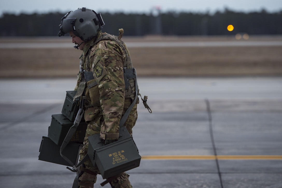 Senior Airman Joseph Lombardi, 41st Rescue Squadron (RQS) special missions aviator, carries empty ammunition cans, Jan. 22, 2018, at Moody Air Force Base, Ga.The 41st RQS is responsible for maintaining combat-ready personnel for recovery missions. To achieve this, members of the squadron constantly train on day and nighttime operations to maintain proficiency. (U.S. Air Force photo by Senior Airman Janiqua P. Robinson)