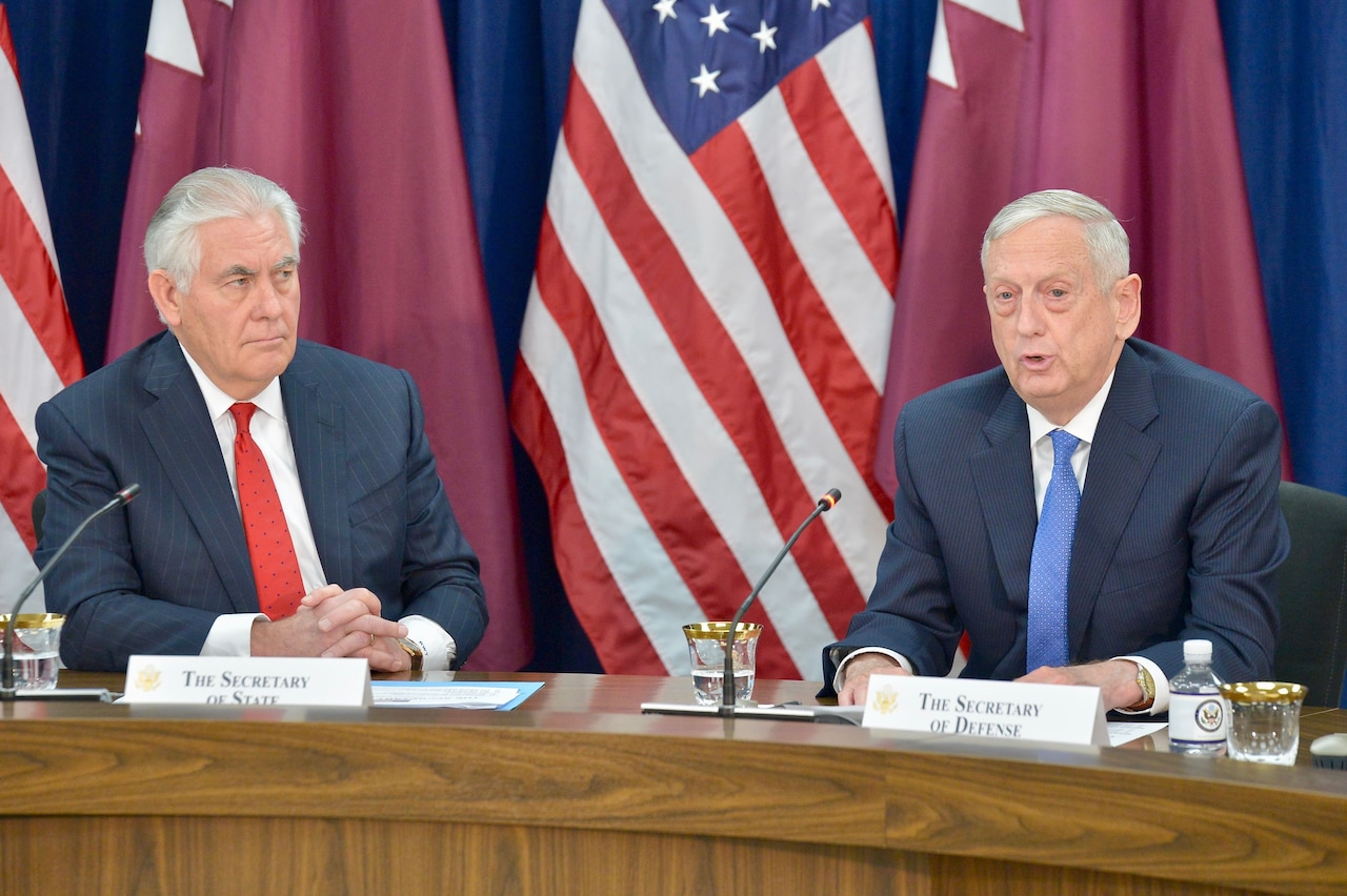 Defense Secretary James N. Mattis, flanked by Secretary of State Rex W. Tillerson, delivers remarks at the opening session of the inaugural U.S.-Qatar Strategic Dialogue at the State Department in Washington.