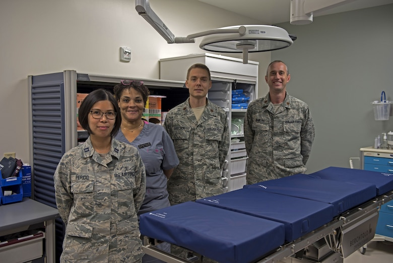 (From left to right) Captain Janice Perido, Kelli Miller-Freeman, Major Jason Babcock, Major Michael Rawlins, all assigned to the 60th Medical Group Surgical Squadron at the David Grant USAF Medical Center at Travis Air Force Base, California, pose for a photo Jan. 25, 2018, at the Bariatric Surgery Clinic at the DGMC at Travis Air Force Base, California. Bariatric surgery includes a variety of procedures on people who have obesity and can potentially help individuals with health issues related to their obesity. (U.S. Air Force photo by Airman 1st Class Jonathon D. A. Carnell)